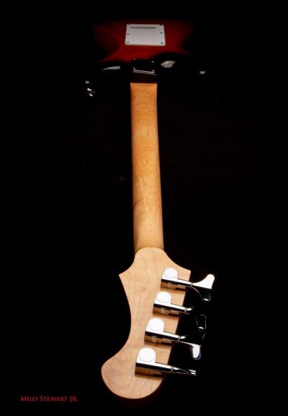 spellcaster bass shot from headstock back
