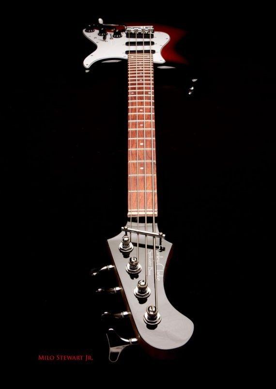 spellcaster bass shot from headstock