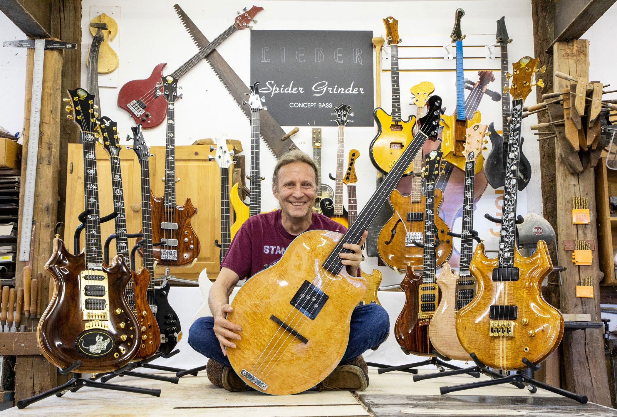 Tom Lieber of Lieber Guitars sitting amongst his guitars